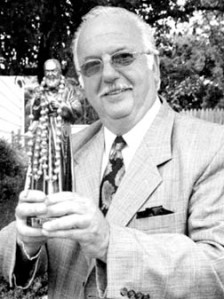 Anthony Fuina displays his statue of Padre Pio